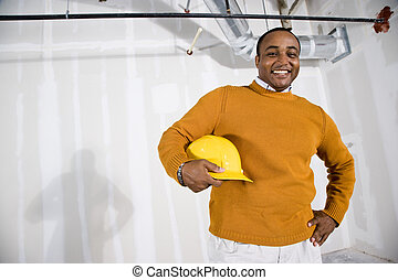 Man in office space ready for buildout - African American...