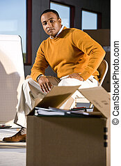 African American man with packed moving box