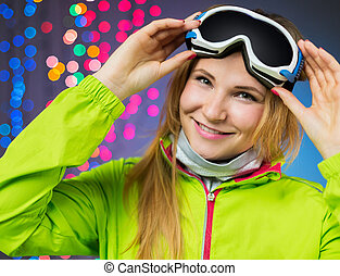 Smiling woman in winterwear on christmas background