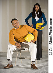 Man and woman in office space ready for buildout -...
