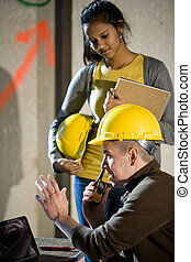 Close-up of male and female construction workers