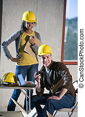 Two young construction workers