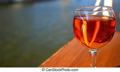 Romantic glass of wine on the table floating cruise ship at...