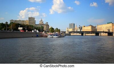 Tour on sunny day across Moscow, Russia. Panorama from ship sailing. HD. 1920x1080