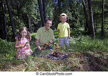 Happy family together near campfire - Parent with daughter...
