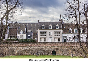 Old houses on the surrounding city wall in Maastricht,...