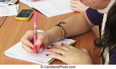 Shool Lesson - Hands writing on the paper
