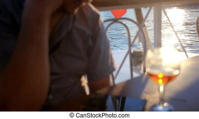 businessman uses smartphone in sea voyage on cruise ship and...