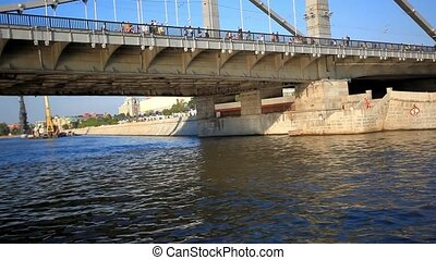 River boat sailing under the bridge. Tour on sunny day across Moscow, Russia. HD. 1920x1080
