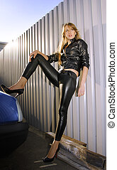 rocker - young woman rocker stands in space between car and...