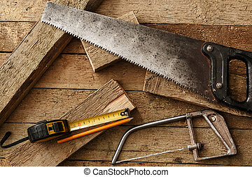 Carpentry tools on wooden surface