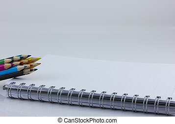 blank notebook isolated with color pencil - blank notebook...