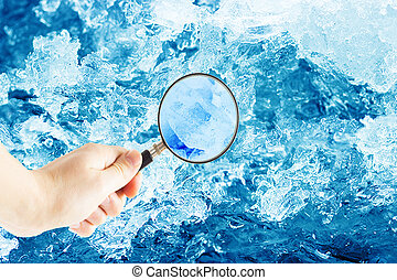 hand with magnifying glass and ice crystals