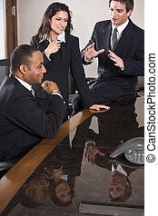 Multi-ethnic business meeting in boardroom - African...