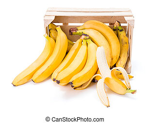 Bananas in wooden crate - Ripe bananas spilling out of...