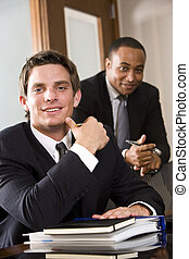Multiethnic businessmen - Young businessman with mature...