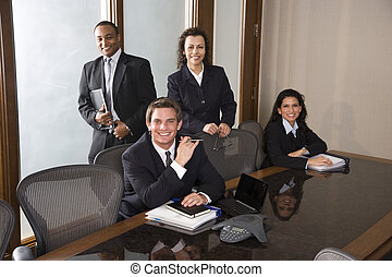 Multi-ethnic business team in boardroom - Young businessman...