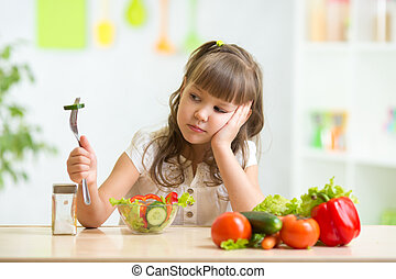 Child looks with disgust for food. - Child girl looks with...
