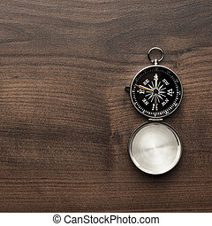 compass on the brown wooden table background