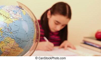 Schoolgirl doing her homework - defocused