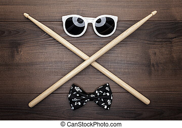wooden drumsticks on wooden table - pair of wooden...