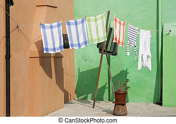 Laundry on line - Clothesline with laundry in front of...