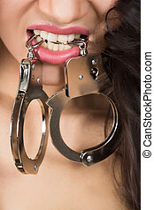 Woman in underwear, bite handcuffs, bdsm, sex toy - Woman in...