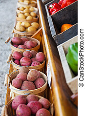 Bushels of Red and White potatos for sale at farmers market...