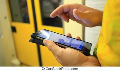 Close up of man hands use mobile phone inside metro HD...