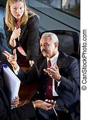 Businessman and businesswoman in a meeting
