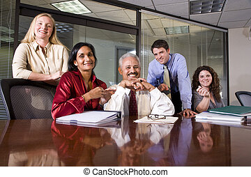 Multiethnic business team meeting in an office conference...