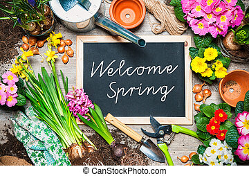 Welcome spring sign - Gardening tools and flowers in the...