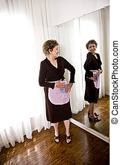 Elderly woman wearing an apron