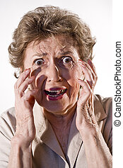 Elderly woman with frightened look on her face