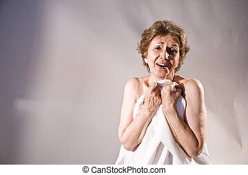 Portrait of ecstatic elderly woman