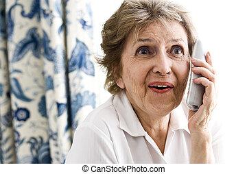 Happy elderly woman talking on phone