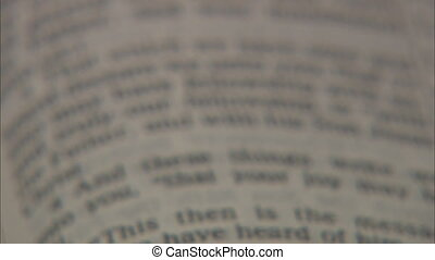 Bible Pan with Shallow DOF - Panning down the pages of an...