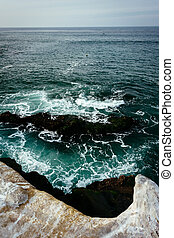 Rocks and waves in the Pacific Ocean, seen from La Jolla, Califo
