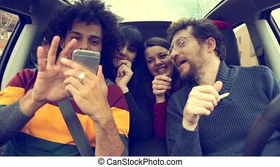 cool people taking selfie in car