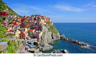 Manarola village on cliff rocks and sea at sunset., Seascape...