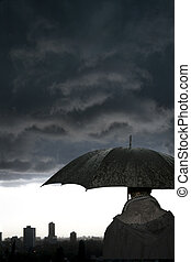 Storm - Man with umbrella in the storm in a winters evening