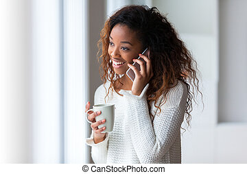 African American woman talking on a mobile phone - Black...