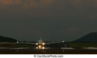 Taxiing - Airplane taxiing after landing in dusk,...