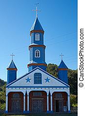 Iglesia de Tenaun - Facade of historic wooden church,...