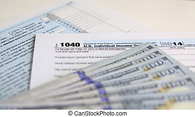 USA Tax Form 1040 with 100 US dollar bills. business concept