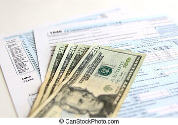 USA Tax Form 1040 with 20 US dollar bills. business concept