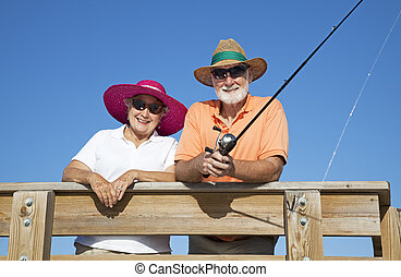 Senior Sun Protection - Senior couple protects themselves...