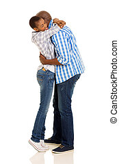 young african couple hugging