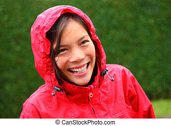 Rain woman smiling - Rain woman. Beautiful young woman in...