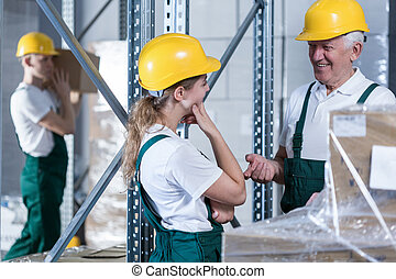 Conversation in warehouse - Conversation between young woman...